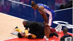 Fan runs onto court during 76ers-Wizards game